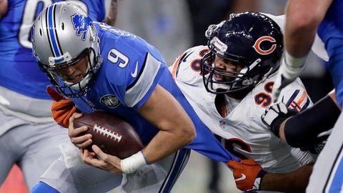 Chicago Bears defensive end Akiem Hicks (96) sacks Detroit Lions quarterback Matthew Stafford (9) in the first half of an NFL football game in Detroit, Sunday, Dec. 11, 2016. (AP Photo/Duane Burleson)