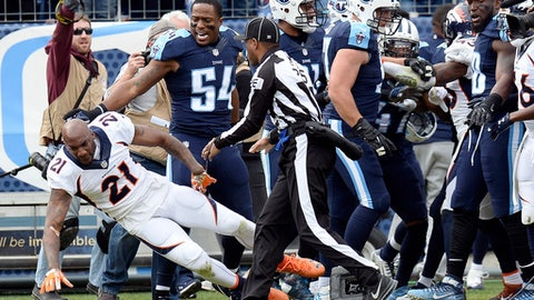 Denver Broncos cornerback Aqib Talib (21) falls to the ground during a scuffle with Tennessee Titans players in the first half of an NFL football game Sunday, Dec. 11, 2016, in Nashville, Tenn. (AP Photo/Mark Zaleski)