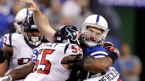 Indianapolis Colts quarterback Andrew Luck, center, is hit as he throws by Houston Texans linebacker Benardrick McKinney (55) and linebacker Whitney Mercilus (59) during the second half of an NFL football game, Sunday, Dec. 11, 2016, in Indianapolis. (AP Photo/Darron Cummings)