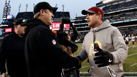 Washington Redskins head coach Jay Gruden right, and Philadelphia Eagles head coach Doug Pederson meet after an NFL football game, Sunday, Dec. 11, 2016, in Philadelphia. (AP Photo/Michael Perez)