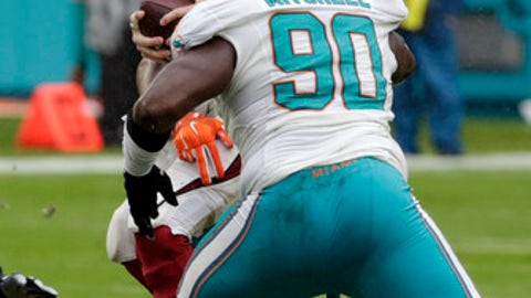 Arizona Cardinals quarterback Carson Palmer (3) is sacked by Miami Dolphins defensive end Cameron Wake, obstructed, during the second half of an NFL football game, Sunday, Dec. 11, 2016, in Miami Gardens, Fla. To the right is Miami Dolphins defensive tackle Earl Mitchell (90). (AP Photo/Wilfredo Lee)