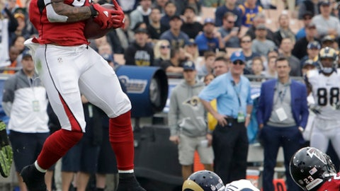 Atlanta Falcons free safety Ricardo Allen, left, intercepts a pass intended for Los Angeles Rams wide receiver Kenny Britt during the first half of an NFL football game, Sunday, Dec. 11, 2016, in Los Angeles. (AP Photo/Rick Scuteri)