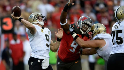 New Orleans Saints quarterback Drew Brees (9) throws a pass as he is pressured by Tampa Bay Buccaneers defensive tackle Gerald McCoy (93) during the second quarter of an NFL football game Sunday, Dec. 11, 2016, in Tampa, Fla. (AP Photo/Jason Behnken)