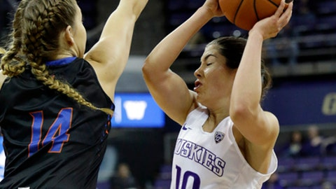 Washington's Kelsey Plum (10) turns to shoot as Boise State's Braydey Hodgins defends in the first half of an NCAA college basketball game, Sunday, Dec. 11, 2016, in Seattle. (AP Photo/Elaine Thompson)