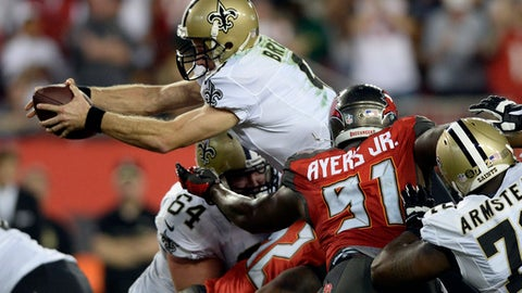 New Orleans Saints quarterback Drew Brees (9) dives over the line of scrimmage for a first down against the Tampa Bay Buccaneers during the second quarter of an NFL football game Sunday, Dec. 11, 2016, in Tampa, Fla. (AP Photo/Jason Behnken)
