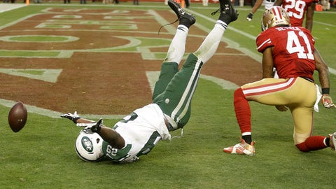 New York Jets running back Bilal Powell (29) celebrates next to San Francisco 49ers strong safety Antoine Bethea (41) after scoring a touchdown during overtime of an NFL football game in Santa Clara, Calif., Sunday, Dec. 11, 2016. The Jets won 23-17. (AP Photo/Ben Margot)