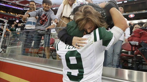 New York Jets quarterback Bryce Petty (9) greets supporters after an NFL football game against the San Francisco 49ers in Santa Clara, Calif., Sunday, Dec. 11, 2016. The Jets won 23-17 in overtime. (AP Photo/Marcio Jose Sanchez)