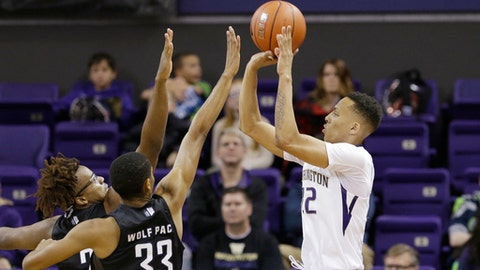 Washington's Dominic Green, right, shoots over Nevada's Josh Hall (33) and Leland King II in the first half of an NCAA college basketball game, Sunday, Dec. 11, 2016, in Seattle. (AP Photo/Elaine Thompson)
