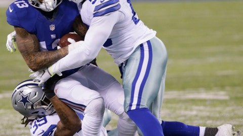 New York Giants wide receiver Odell Beckham (13) is tackled by Dallas Cowboys' Justin Durant (56) and Brandon Carr (39) during the first half of an NFL football game Sunday, Dec. 11, 2016, in East Rutherford, N.J. (AP Photo/Seth Wenig)