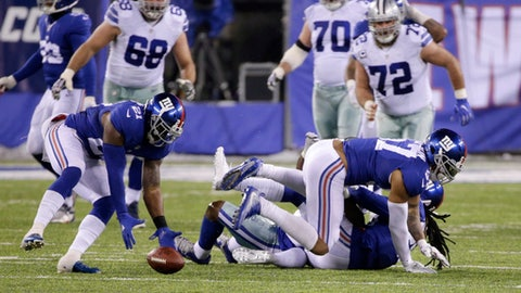 New York Giants strong safety Landon Collins (21) recovers a ball fumbled by Dallas Cowboys' Dez Bryant (88) during the second half of an NFL football game Sunday, Dec. 11, 2016, in East Rutherford, N.J. (AP Photo/Seth Wenig)