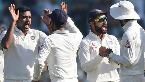 Indian players celebrate the wicket of England's batsman Jonny Bairstow on the fifth day of the fourth cricket test match between India and England in Mumbai, India, Monday, Dec. 12, 2016. (AP Photo/Rafiq Maqbool)