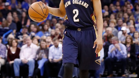 New Orleans Pelicans guard Tim Frazier (2) dribbles down the court against the Oklahoma City Thunder during the first half of an NBA basketball game in Oklahoma City, Sunday, Dec. 4, 2016. (AP Photo/Alonzo Adams)