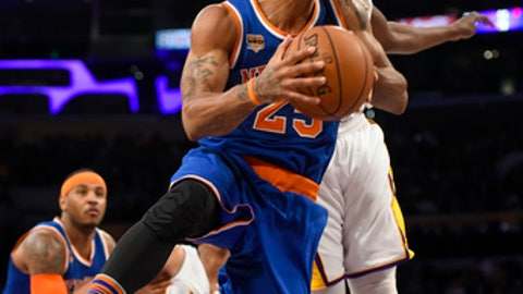 New York Knicks guard Derrick Rose (25) gets by Los Angeles Lakers forward Luol Deng, back right, of South Sudan, for a basket during the first half of an NBA basketball game, Sunday, Dec. 11, 2016, in Los Angeles.(AP Photo/Gus Ruelas)