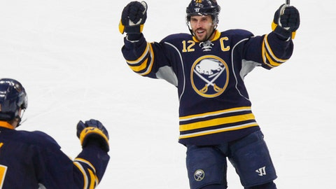 Buffalo Sabres forward Brian Gionta (12) celebrates his goal during the second period of an NHL hockey game against the Los Angeles Kings, Tuesday, Dec. 13, 2016, in Buffalo, N.Y. (AP Photo/Jeffrey T. Barnes)
