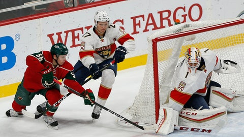 Florida Panthers' goalie Roberto Luongo stops the puck from Minnesota Wild's Erik Haula (56) in the first period of an NHL hockey game Tuesday, Dec. 13, 2016, in St. Paul, Minn.(AP Photo/Stacy Bengs)