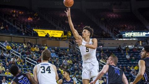 Michigan's D.J. Wilson (5) shoots against Central Arkansas during the first half of an NCAA college basketball game Tuesday, Dec. 13, 2016, in Ann Arbor, Mich. (Matt Weigand/The Ann Arbor News via AP)
