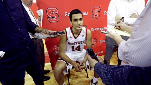 FILE - In this Sept. 29, 2016, file photo, North Carolina State's Omer Yurtseven, of Turkey, takes questions during the NCAA college basketball team's media day in Raleigh, N.C. urtseven's wait to play for North Carolina State is finally over. The NCAA required the Turkish 7-footer and five-star freshman to sit the Wolfpack's first nine games after examining his amateur eligibility status following an overseas career, but he's set to play Thursday night against Appalachian State. (AP Photo/Gerry Broome, File)