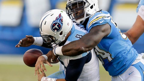 FILe - In this Nov. 6, 2016, file photo, Tennessee Titans quarterback Marcus Mariota, left, fumbles the ball as he is brought down by San Diego Chargers outside linebacker Melvin Ingram during the second half of an NFL football game, in San Diego. The Chargers recovered the ball and scored a touchdown on the play. The Titans, and Mariota in particular, are doing a much better job taking care of the football having gone four straight games without a turnover. That will be crucial Sunday when they visit the Chiefs.(AP Photo/Rick Scuteri, File)