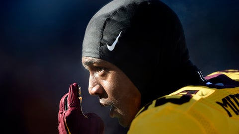 FILE - In this Nov. 21, 2015, file photo, Minnesota's defensive back Ray Buford (25) watches warmups before an NCAA college football game against Illinois, in Minneapolis. Buford is one of ten Minnesota football players suspended this week following a fresh investigation into an alleged sexual assault at an off-campus apartment in September, the father of a player and an attorney for several players said Wednesday, Dec. 14, 2016. Ray Buford Sr., the father of defensive back Ray Buford Jr., said the new suspensions resulted from an investigation by the university's Office of Equal Opportunity and Affirmative Action that was separate from earlier investigations into the alleged assault in the early hours of Sept. 3. He confirmed that an attorney for his son and other players planned to appeal. (AP Photo/Hannah Foslien, File)