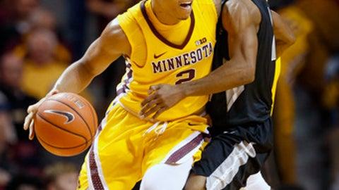 LIU Brooklyn guard Jashaun Agosto (2) fouls Minnesota guard Nate Mason (2) as he dribbles in the first half of an NCAA college basketball game Wednesday, Dec. 14, 2016, in Minneapolis. (AP Photo/Bruce Kluckhohn)