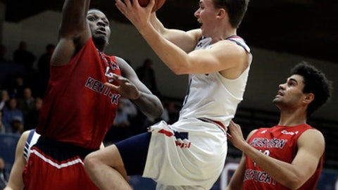 Saint Mary's Emmett Naar, center, shoots against Western Kentucky's Anton Waters during the first half of an NCAA college basketball game Wednesday, Dec. 14, 2016, in Moraga, Calif. (AP Photo/Ben Margot)