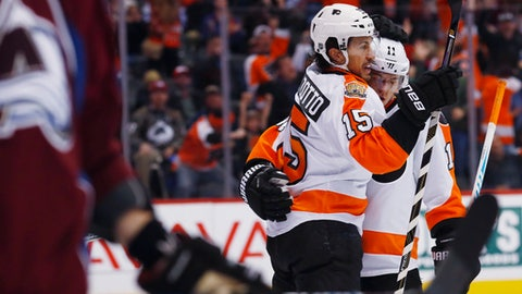Philadelphia Flyers defenseman Michael Del Zotto, left, celebrates scoring a goal with center Travis Konecny against the Colorado Avalanche in the second period of an NHL hockey game, Wednesday, Dec. 14, 2016, in downtown Denver. (AP Photo/David Zalubowski)