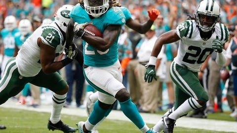 FILE - In this Nov. 6, 2016, file photo, Miami Dolphins running back Jay Ajayi (23) runs for a touchdown during the first half of an NFL football game against the New York Jets, in Miami Gardens, Fla. The surprising success by such low-profile rushers as Jay Ajayi, Jordan Howard, Robert Kelley and Tim Hightower speaks to the challenge of evaluating running backs _ and the high injury rate at the position. (AP Photo/Wilfredo Lee, File)