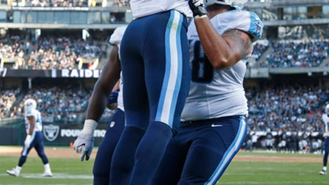 FILE - In this Aug. 24, 2016, file photo, Tennessee Titans rookie running back Derrick Henry (22) celebrates with rookie offensive lineman Jack Conklin, right, after scoring a touchdown during an NFL preseason football game against the Oakland Raiders in Oakland, Calif. Getting rookies ready to play their first season in the NFL can be a challenge. The top draft picks usually hit the field early, but the Titans have managed to play all 10 of their draft picks at least one game this season. It's helped them tie for the AFC South lead as they prepare to visit Kansas City. (AP Photo/Tony Avelar, File)