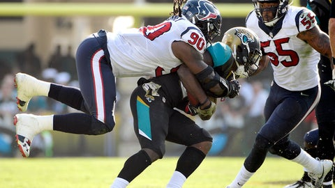 FILE - In this Nov. 13, 2016, file photo, Jacksonville Jaguars running back T.J. Yeldon, center, is tackled by Houston Texans defensive end Jadeveon Clowney (90) after a short gain during the second half of an NFL football game in Jacksonville, Fla. Clowney had perhaps the best game of his career last week against Indianapolis. The Houston Texans are being careful to avoid a letdown on Sunday against the Jacksonville Jaguars, who are losers of eight straight. (AP Photo/Phelan M. Ebenhack, File)