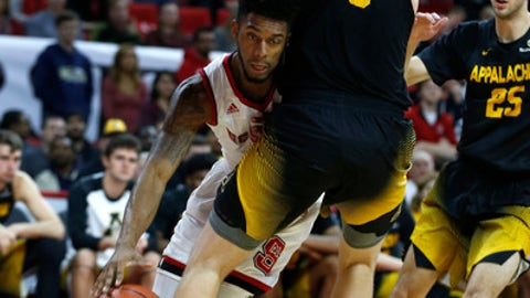 North Carolina State's Terry Henderson (3) drives as Appalachian State's Griffin Kinney (5) defends during the first half of an NCAA college basketball game at PNC Arena in Raleigh, N.C., Thursday, Dec. 15, 2016. (Ethan Hyman/The News & Observer via AP)