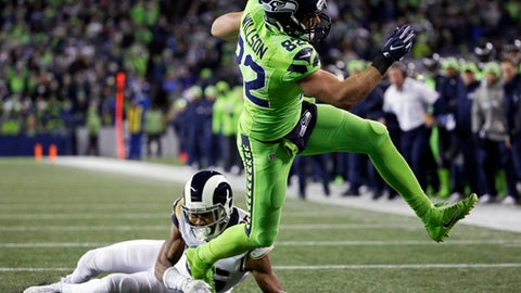 Seattle Seahawks tight end Luke Willson, right, avoids a tackle from Los Angeles Rams defensive back Michael Jordan to score a touchdown in the first half of an NFL football game, Thursday, Dec. 15, 2016, in Seattle. (AP Photo/Elaine Thompson)