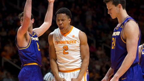 Tennessee's Grant Williams, center, yells after drawing a foul from Lipscomb's Rob Marberry, left, while scoring during the second half of an NCAA college basketball game in Knoxville, Tenn., Thursday, Dec. 15, 2016. (Caitie McMekin/Knoxville News Sentinel via AP)