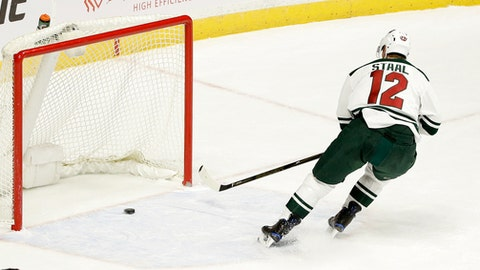 Minnesota Wild center Eric Staal scores an open-net goal during the third period for his second goal of an NHL hockey game against the Nashville Predators, Thursday, Dec. 15, 2016, in Nashville, Tenn. (AP Photo/Mark Humphrey)
