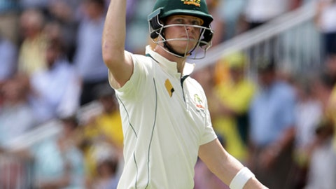 Australia's Steve Smith waves to the crowd as he leaves the field after he was dismissed for a 130 runs during play on day two of the first cricket test between Australia and Pakistan in Brisbane, Australia, Friday, Dec. 16, 2016. (AP Photo/Tertius Pickard)