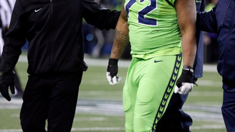 Seattle Seahawks defensive end Michael Bennett is helped off the field with an injury in the second half of an NFL football game against the Los Angeles Rams, Thursday, Dec. 15, 2016, in Seattle. (AP Photo/Elaine Thompson)