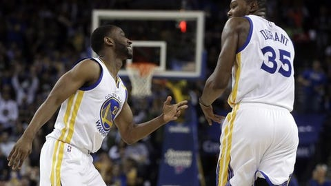 Golden State Warriors' Ian Clark, left, celebrates a score against the New York Knicks with Kevin Durant (35) during the second half of an NBA basketball game Thursday, Dec. 15, 2016, in Oakland, Calif. (AP Photo/Ben Margot)