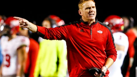FILE - In this Nov. 17, 2016, file photo, Arkansas State coach Blake Anderson reacts to a call during the second half of the team's NCAA college football game against Troy, in Troy, Ala. Arkansas State and UCF certainly have a lot in common heading into Saturday's AutoNation Cure Bowl matchup. Both are led by their defenses, have developing high-octane offenses and have made the postseason after impressive turn-around seasons. (AP Photo/Butch Dill, File)