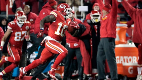 FILE - In this Dec. 8, 2016, file photo, Kansas City Chiefs wide receiver Tyreek Hill (10) returns a kickoff ball for a touchdown during the first half of an NFL football game against the Oakland Raiders in Kansas City, Mo. After watching Kansas City Chiefs rookie Tyreek Hill speed into the end zone on a return, a rush and a reception last month, Broncos coach Gary Kubiak decided to give his own dashing dynamo a chance. (AP Photo/Charlie Riedel, File)