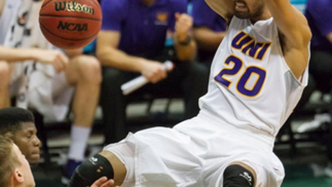 FILE - In this Dec. 23, 2015, file photo, Northern Iowa guard Jeremy Morgan (20) makes a dunk while playing against Washington State in the second half of an NCAA college basketball game at the Diamond Head Classic, in Honolulu. Long before they developed two of the better players in America, Iowa's Peter Jok and Northern Iowa's Jeremy Morgan were friends and rivals on the state's summer hoops circuit. Jok and Morgan will meet again Saturday in Des Moines. (AP Photo/Eugene Tanner, File)