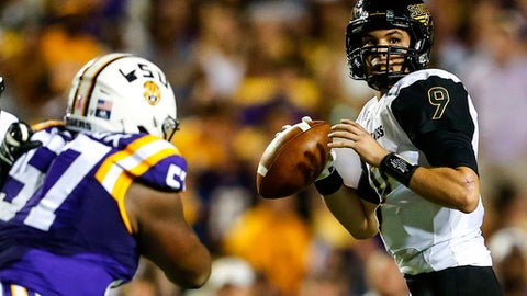 FILE - In a Saturday, Oct. 15, 2016 file photo, Southern Mississippi quarterback Nick Mullens (9) drops back to pass against LSU during the first half of an NCAA college football game in Baton Rouge, La. Southern Miss QB Nick Mullens is the Golden Eagles' all-time passing leader with 11,648 yards. The senior is healthy after playing with an injured thumb earlier this season and then missing a couple late-season games with a concussion.(AP Photo/Butch Dill, File)
