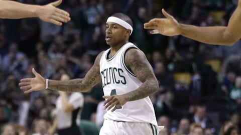 Boston Celtics guard Isaiah Thomas celebrates with teammates in the fourth quarter of an NBA basketball game against the Charlotte Hornets, Friday, Dec. 16, 2016, in Boston. Thomas led all scorers with 26 points as the Celtics won 96-88. (AP Photo/Elise Amendola)