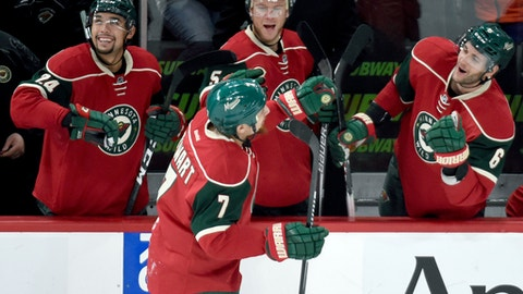 Minnesota Wild's Matt Dumba (24), Christian Folin (5), of Sweden, and Marco Scandella (6) congratulate Chris Stewart (7) on scoring a goal against the Arizona Coyotes during the third period of an NHL hockey game Saturday, Dec. 17, 2016, in St. Paul, Minn. The Wild won 4-1. (AP Photo/Hannah Foslien)