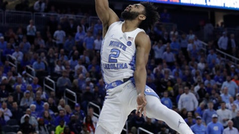 North Carolina's Joel Berry II shoots against Kentucky during the first half of an NCAA college basketball game Saturday, Dec. 17, 2016, in Las Vegas. (AP Photo/John Locher)