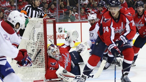 Washington Capitals goalie Braden Holtby (70) deflects a shot by Montreal Canadiens left wing Phillip Danault (24), during the first period of an NHL hockey game in Washington, Saturday, Dec. 17, 2016, while Capitals John Carlson (74) defends. (AP Photo/Manuel Balce Ceneta)