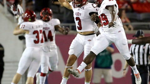 Arkansas State celebrates a first quarter touchdown against Central Florida during the Cure Bowl NCAA college football game in Orlando, Fla., Saturday, Dec. 17, 2016. (Joe Burbank/Orlando Sentinel via AP)