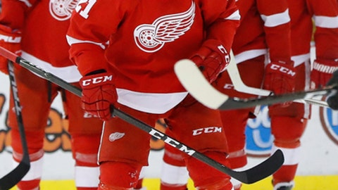 Detroit Red Wings left wing Tomas Tatar (21) skates past hats on the ice after scoring against the Anaheim Ducks in the third period of an NHL hockey game Saturday, Dec. 17, 2016, in Detroit. This was his third goal of the game. (AP Photo/Paul Sancya)