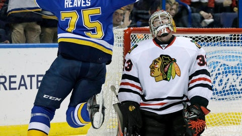 St. Louis Blues' Ryan Reaves (75) celebrates a goal by teammate Kyle Brodziak as Chicago Blackhawks goalie Scott Darling (33) reacts in the second period of an NHL hockey game, Saturday, Dec. 17, 2016, in St. Louis. (AP Photo/Tom Gannam)