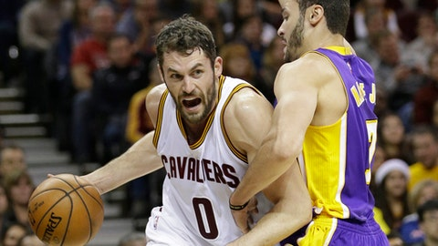 Cleveland Cavaliers' Kevin Love, left, drives past Los Angeles Lakers' Larry Nance Jr. in the first half of an NBA basketball game Saturday, Dec. 17, 2016, in Cleveland. (AP Photo/Tony Dejak)