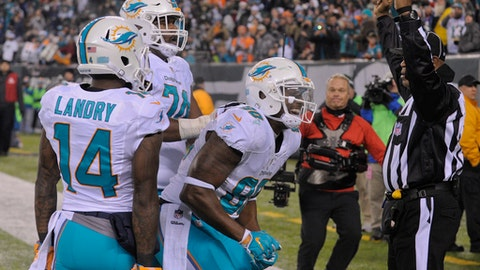 Miami Dolphins tight end Dion Sims (80) celebrates with teammates after scoring a touchdown against the New York Jets during the third quarter of an NFL football game, Saturday, Dec. 17, 2016, in East Rutherford, N.J. (AP Photo/Bill Kostroun)
