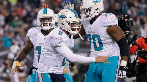 Miami Dolphins quarterback Matt Moore (8) and wide receiver Jarvis Landry (14) celebrate with tackle Ja'Wuan James (70) after Landry scored a touchdown against the New York Jets during the third quarter of an NFL football game, Saturday, Dec. 17, 2016, in East Rutherford, N.J. (AP Photo/Adam Hunger)